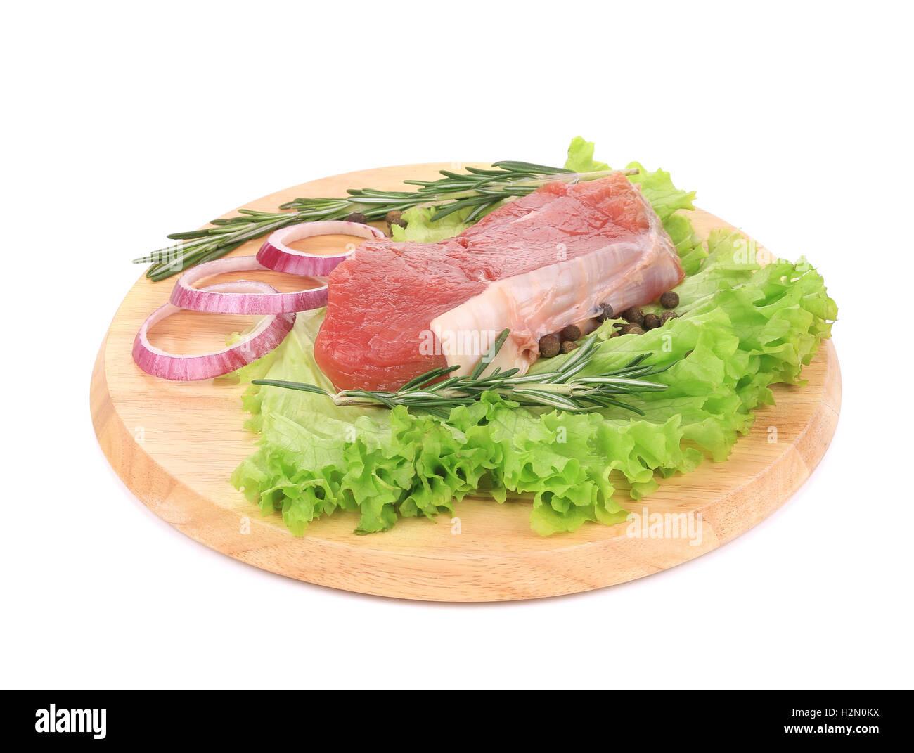 Raw beefsteak on platter. Stock Photo