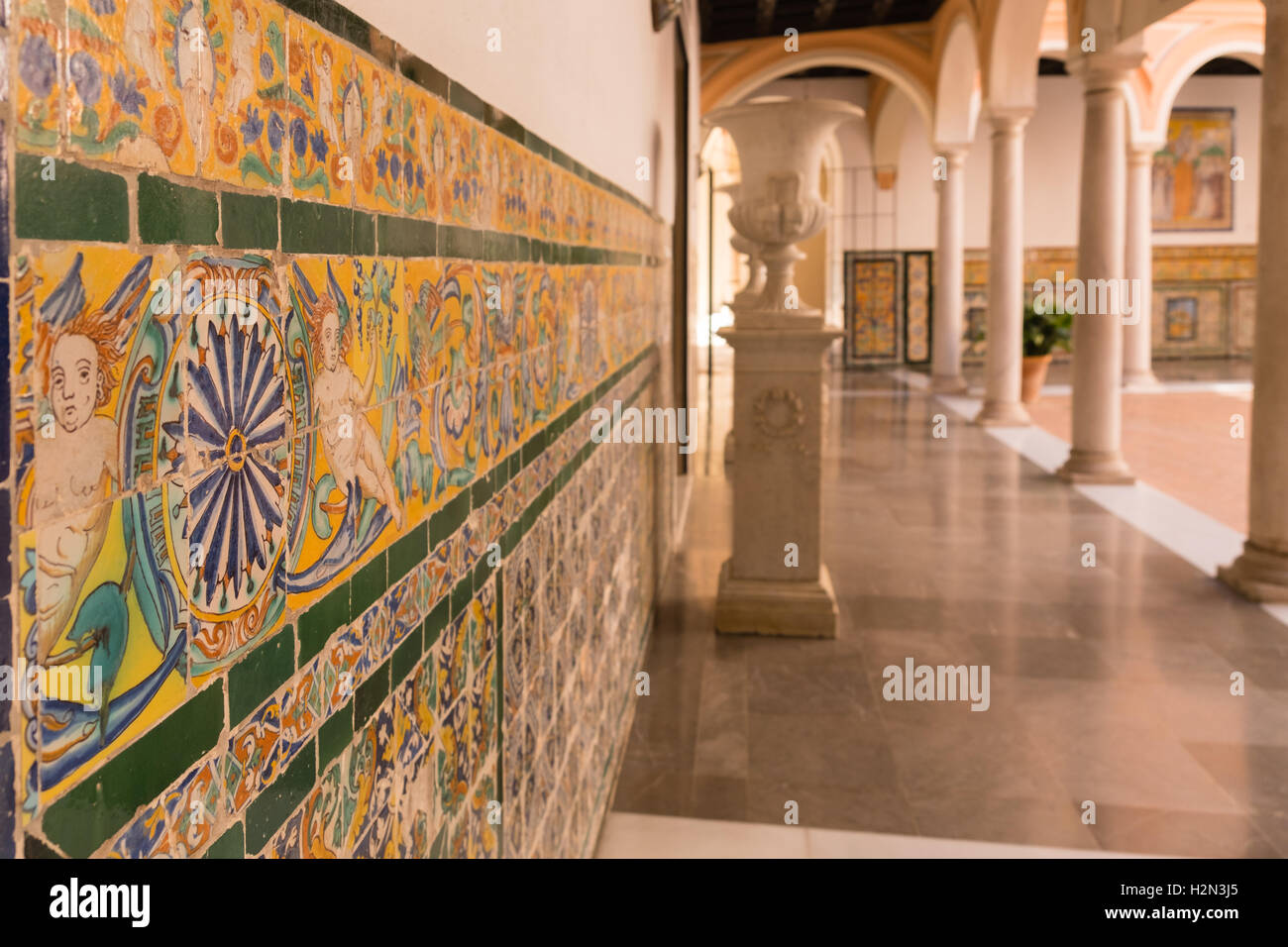 Decoratively painted tiles in Seville city museum - Stock Image