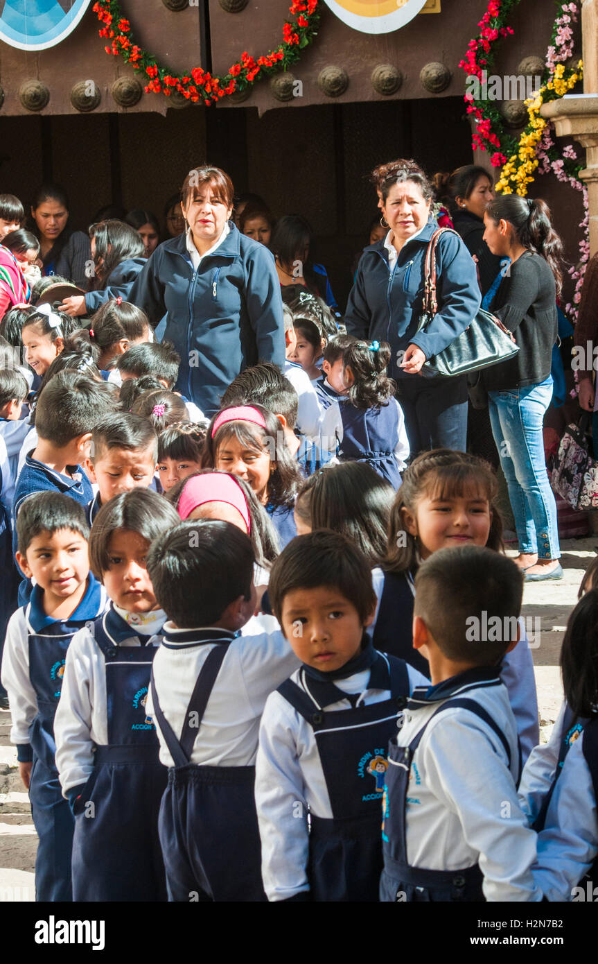 Schoolchildren and teachers leaving a special mass at the Metropolitan Cathedral, Sucre - Stock Image