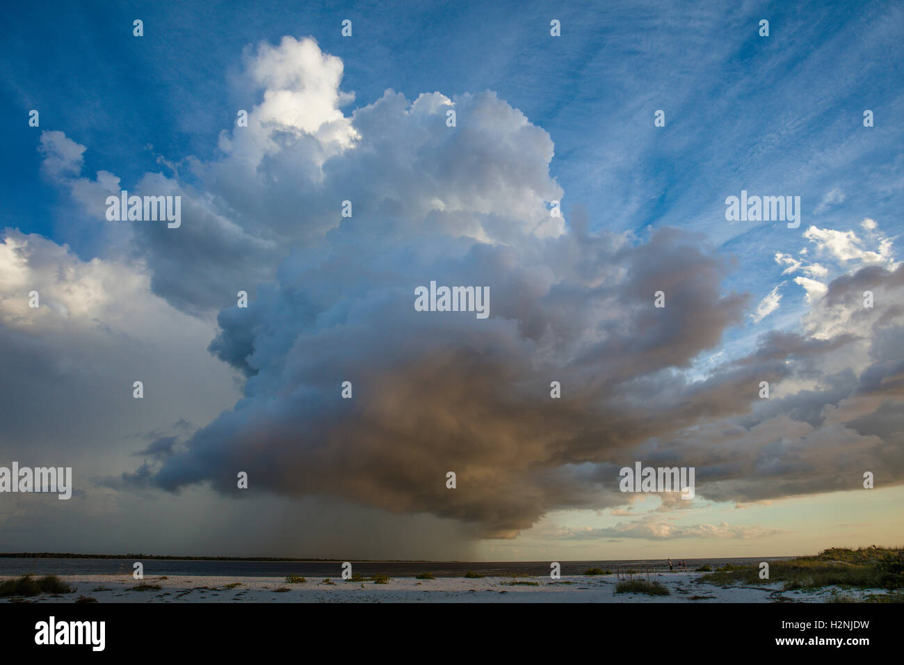 Huge rain storm cloud over Gulf of Mexico from Gasparilla Island Florida - Stock Image