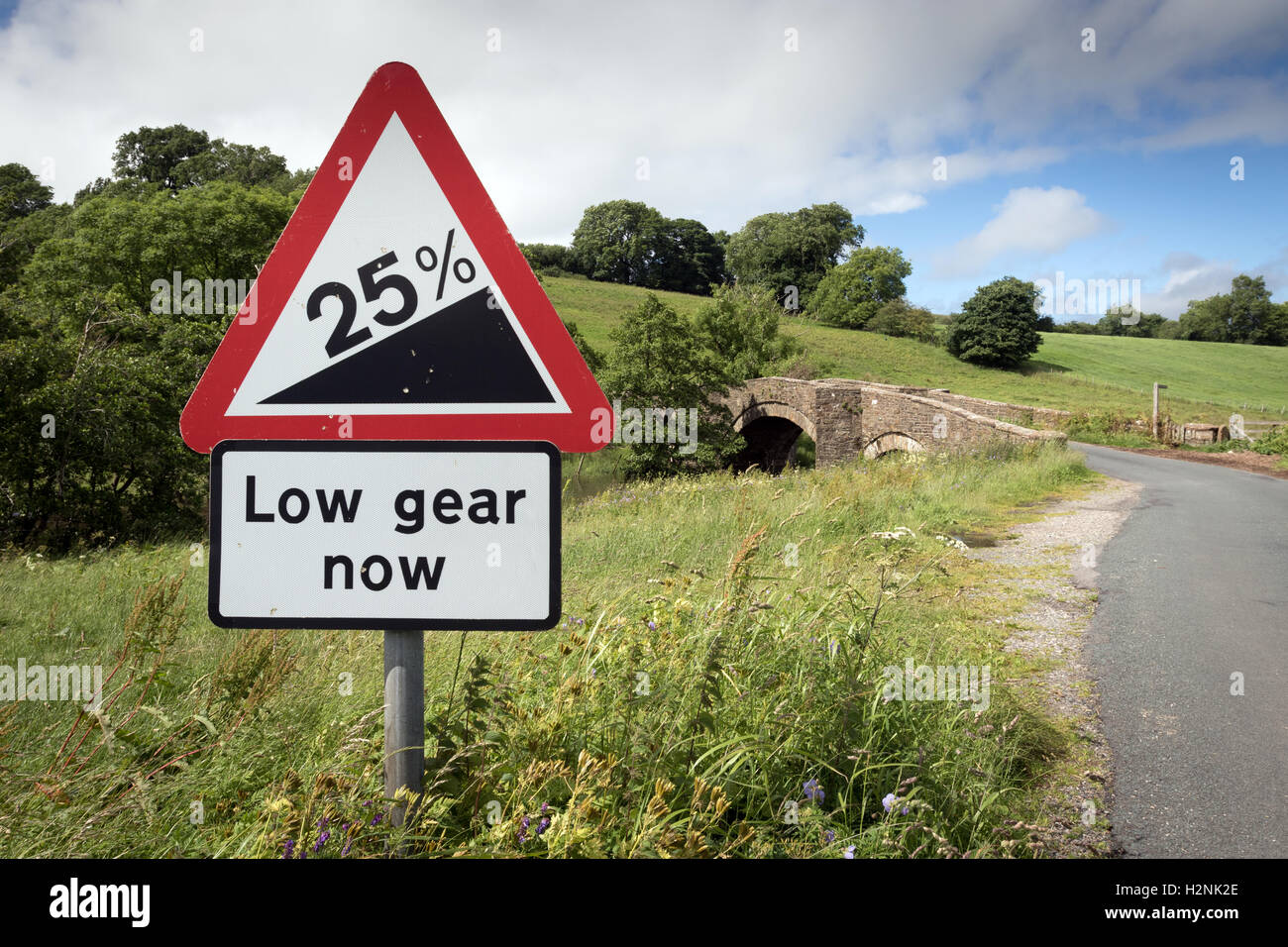 A road sign warning of a steep hill ahead in the Yorkshire Dales - Stock Image