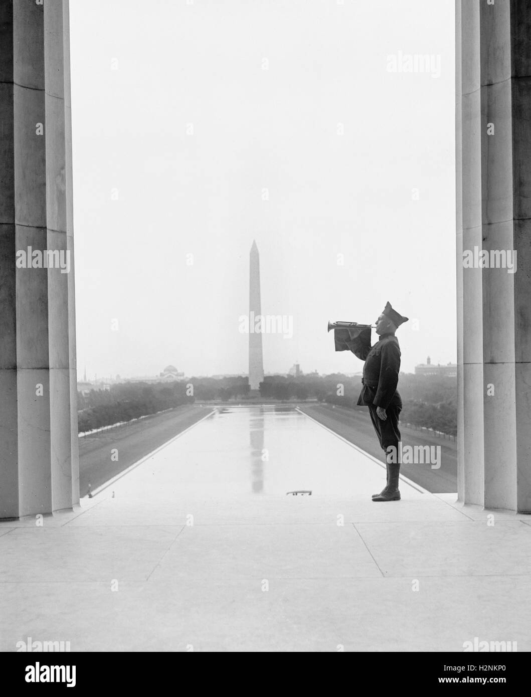 Soldier Playing Taps after Funeral of U.S. President Warren G. Harding, Washington Monument in Background, Washington - Stock Image