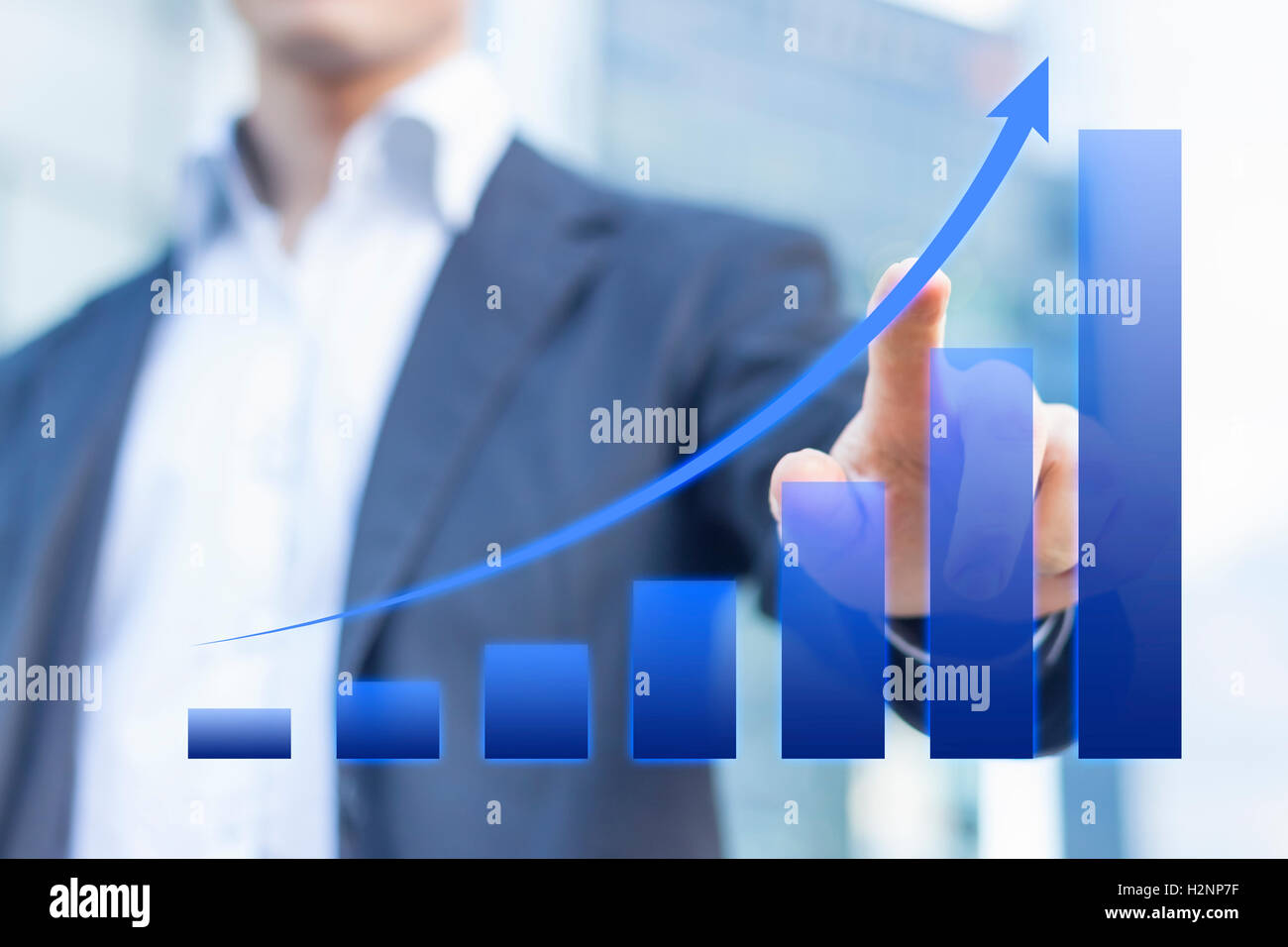 Business consultant presenting a blue chart about growing markets with office buildings in background Stock Photo