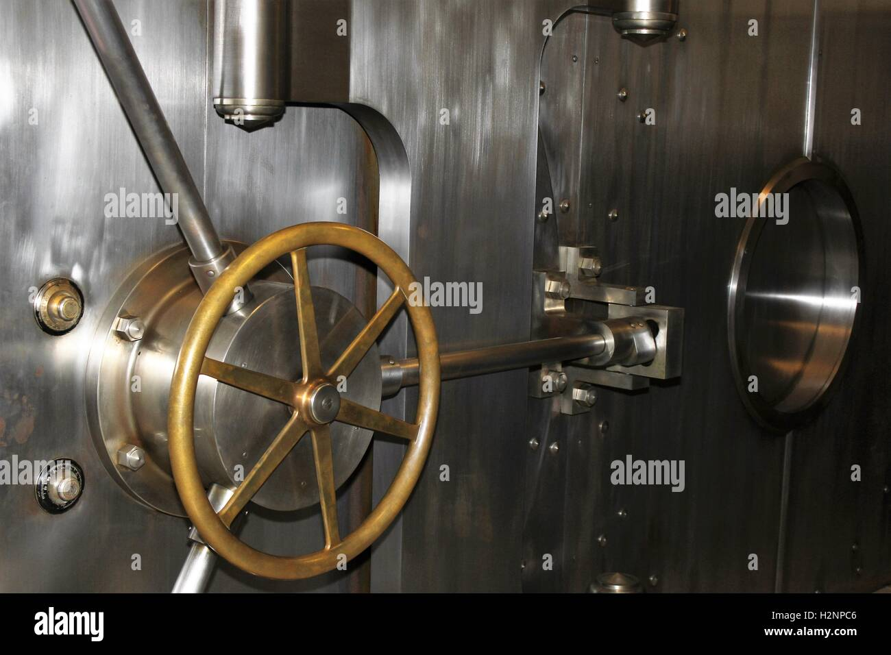 stainless steel and brass bank vault bank door - Stock Image