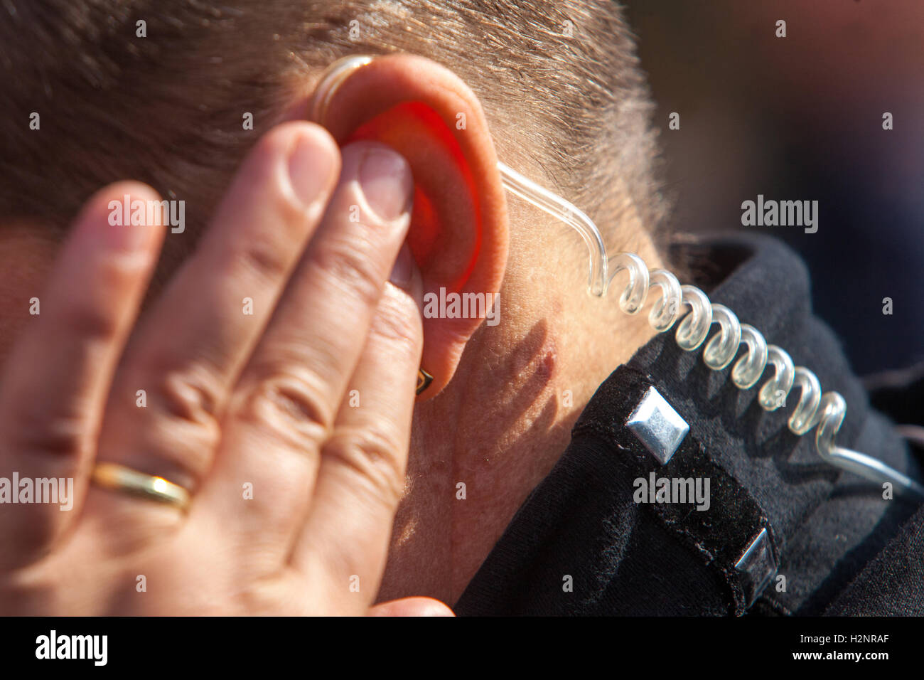 Bodyguard and earpieces, detail ear, security Stock Photo