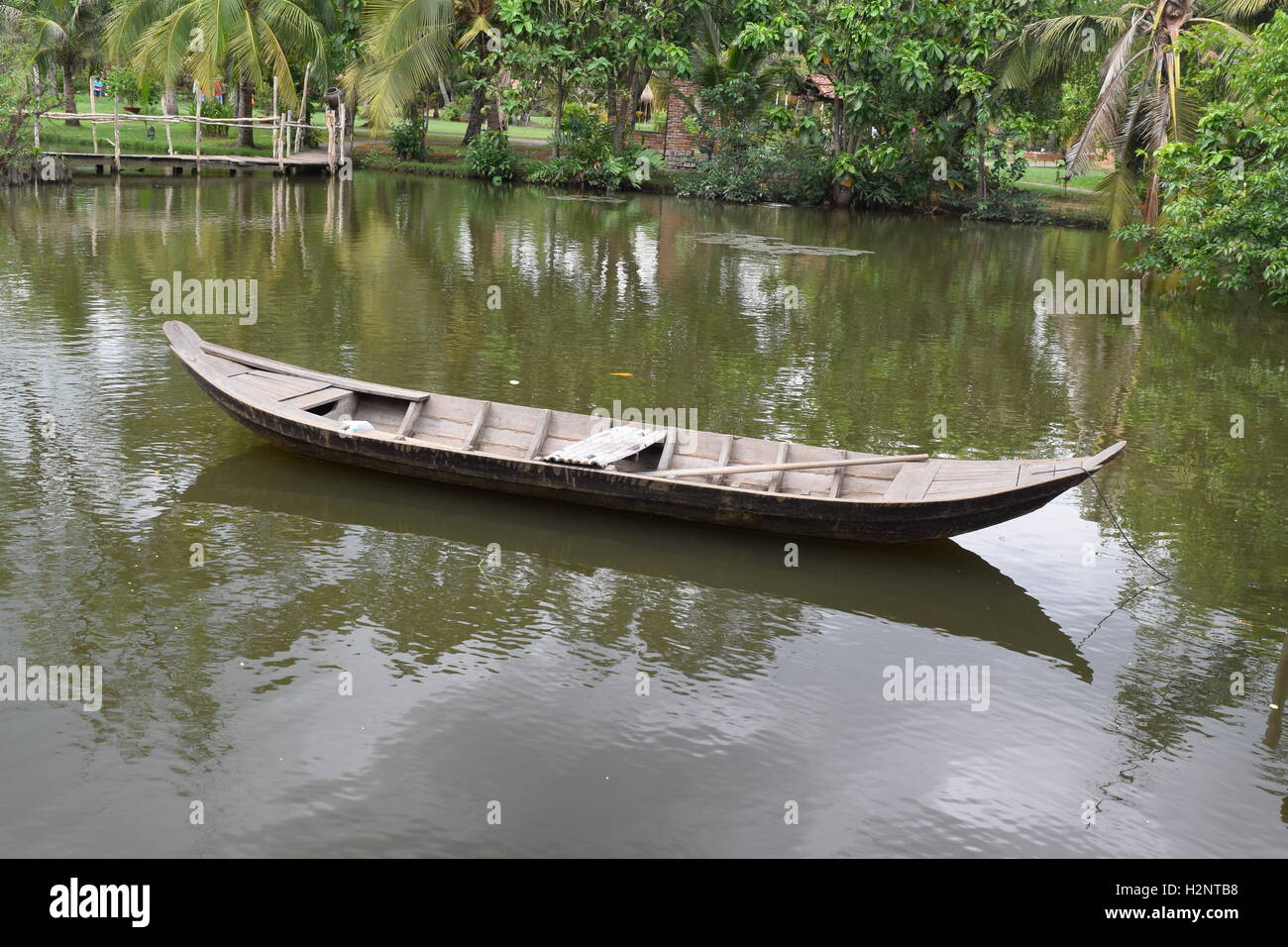 traditional asian fishing boat in river, vietnam Stock Photo