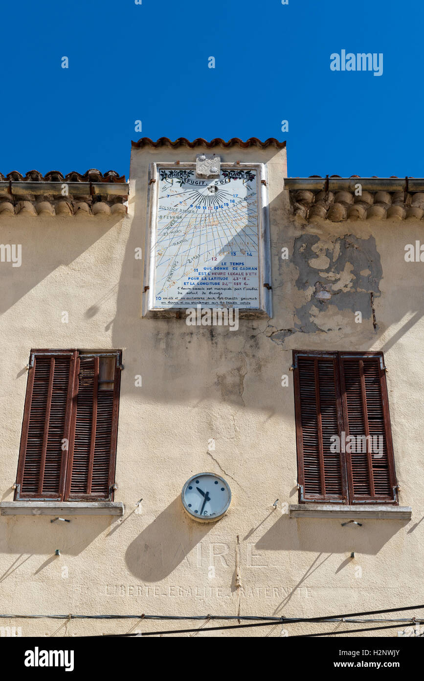 Sundial and analog clock on house wall, Solliès-Toucas, Provence-Alpes-Côte d'Azur region, southeastern - Stock Image