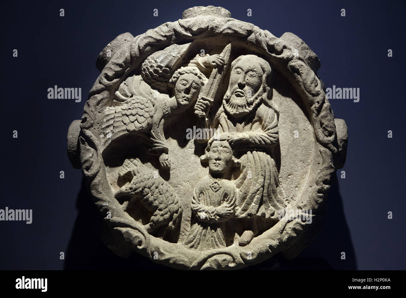 Sacrifice of Isaac. Romanesque relief from circa 1220-1230 from the Sauve-Majeure Abbey in Gironde, currently displayed - Stock Image