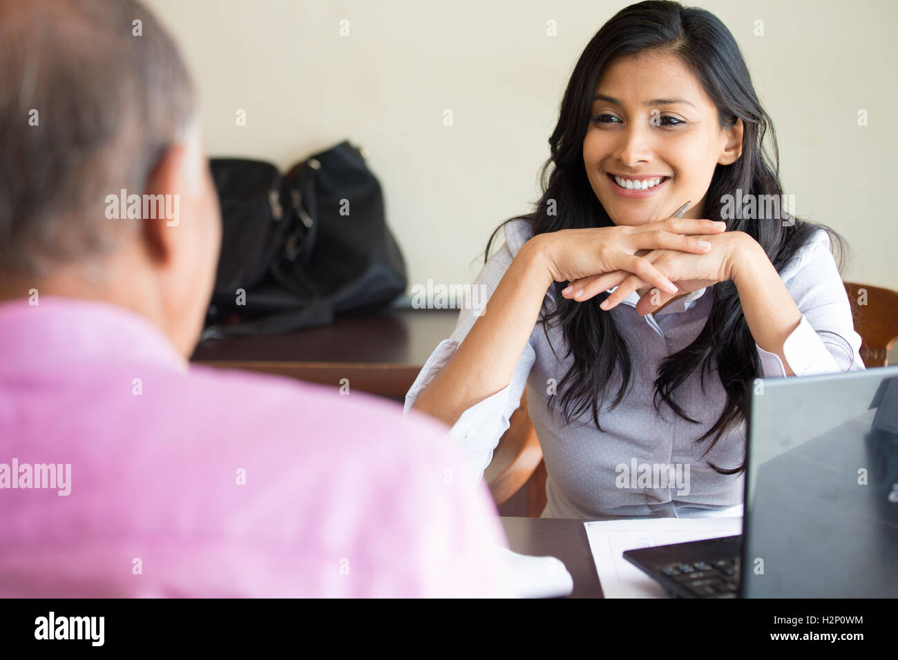 Closeup portrait, appointment with office manager, job interview, hiring, isolated indoors office background. - Stock Image