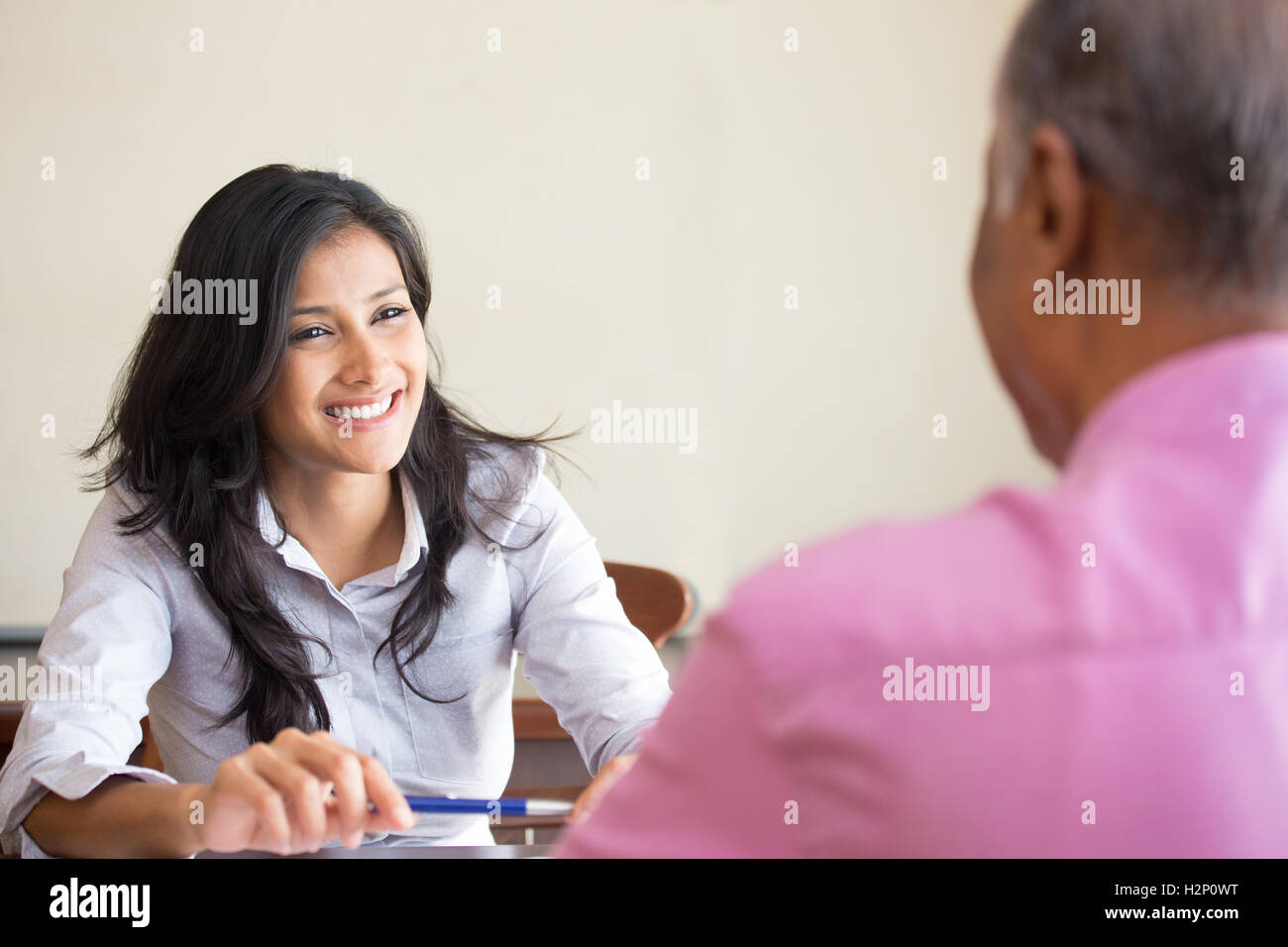 Closeup portrait, appointment with office manager, job interview, hiring, isolated indoors office background. Getting - Stock Image