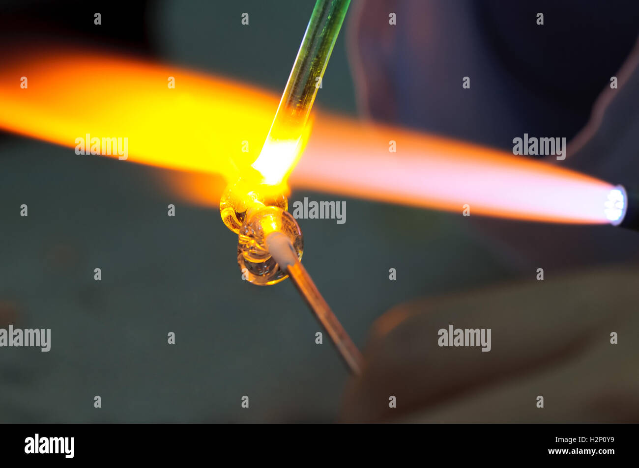 The art of shaping glass using fire. - Stock Image