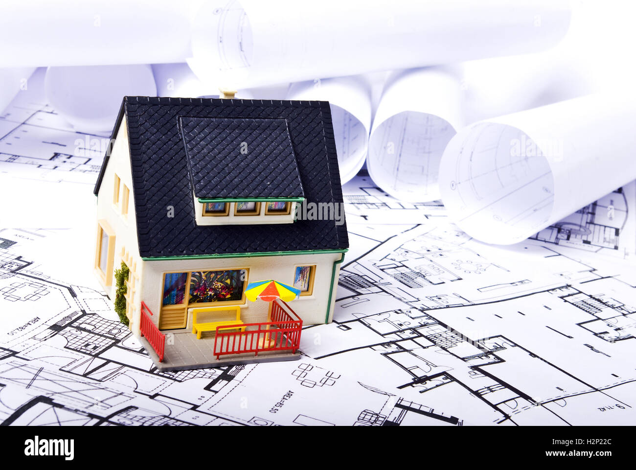 model house on plans background Stock Photo