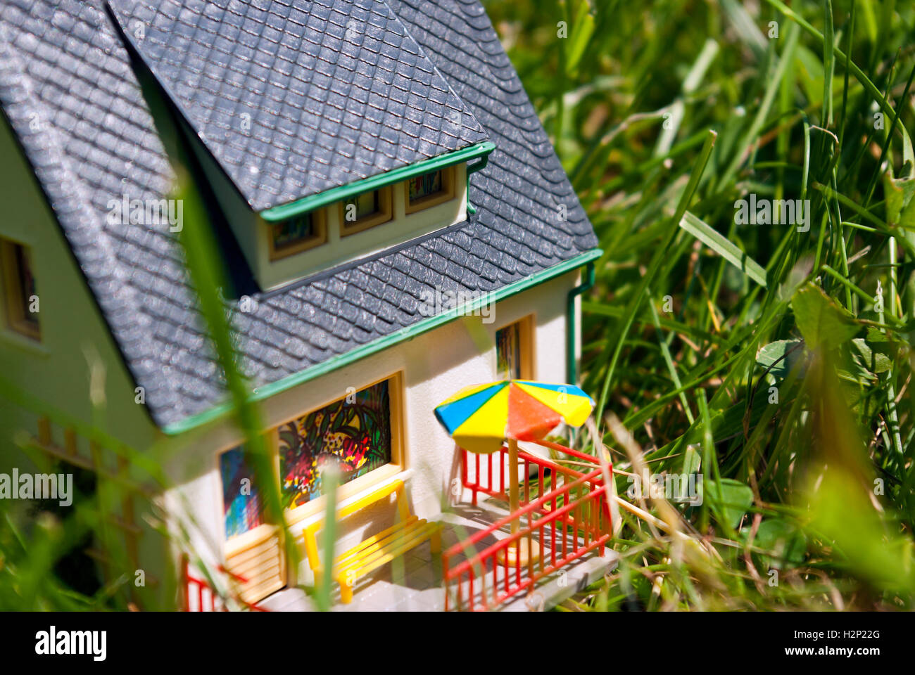 big close up of house in grass - Stock Image