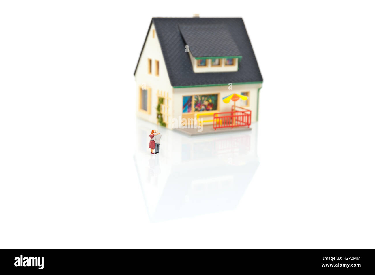 miniature people with house - Stock Image