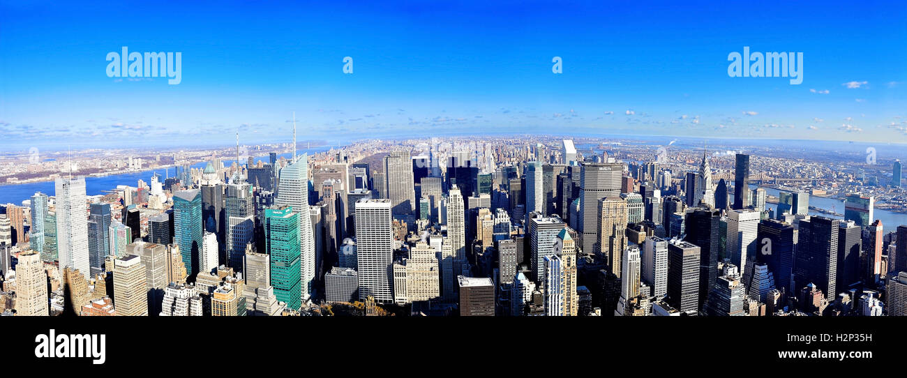 Full view of New York Cities Skyline, Midtown Manhattan Island, New York City on a clear day with a bright blue - Stock Image