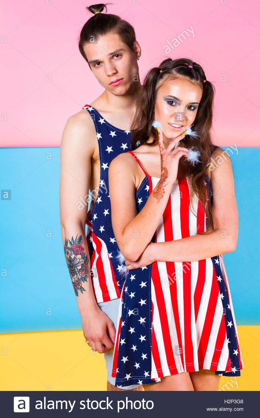 Model Couple posing in USA outfits stars and stripes vest and dress for a high summer photoshoot. - Stock Image