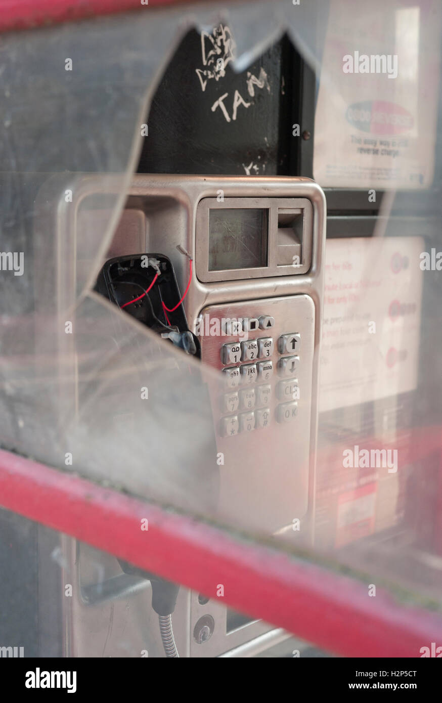 Vandalized telephone box. Stock Photo
