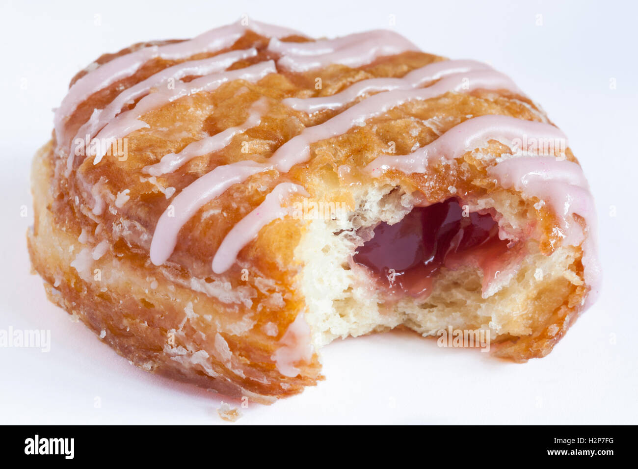 m s raspberry yum yums iced doughnut bitten into isolated. Black Bedroom Furniture Sets. Home Design Ideas