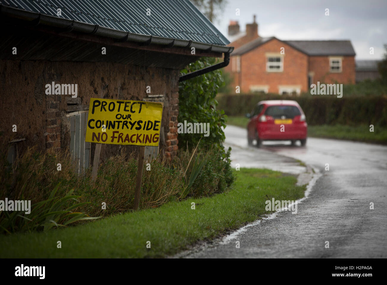 Anti-fracking signs in the village of Woodsfold, close to the proposed site at Roseacre Wood, Lancashire where fracking - Stock Image