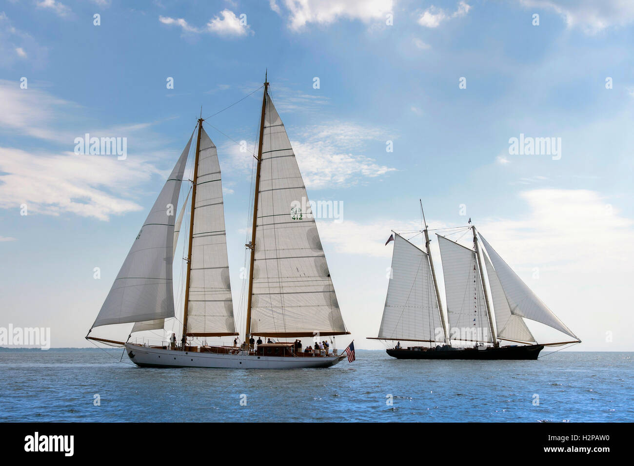 The U.S. Naval Academy training sailboat Summerwind, left, sails to welcome the 139-foot yacht America, replica - Stock Image