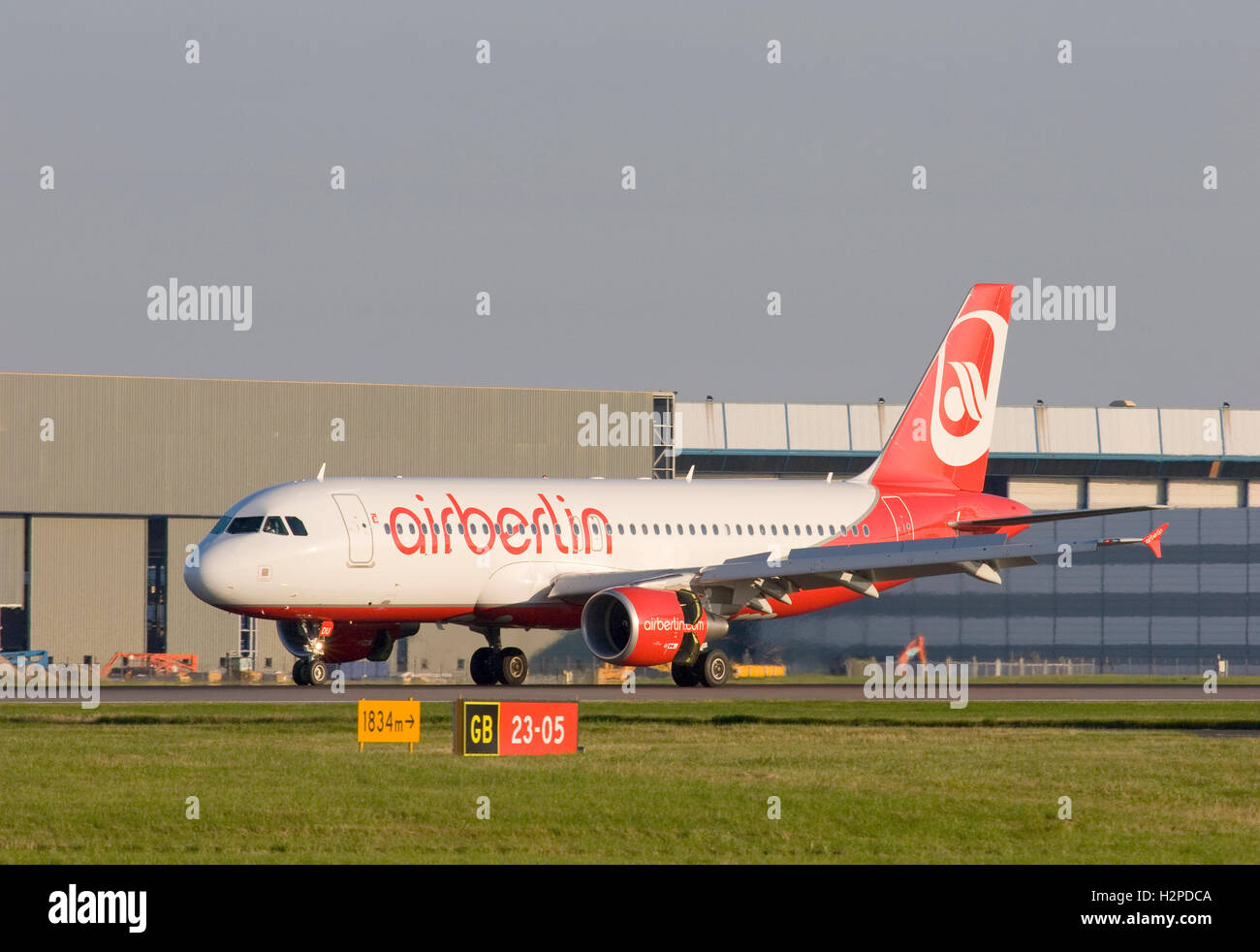 Air Berlin Airbus A320-214 aircraft landing at London Stansted airport. - Stock Image