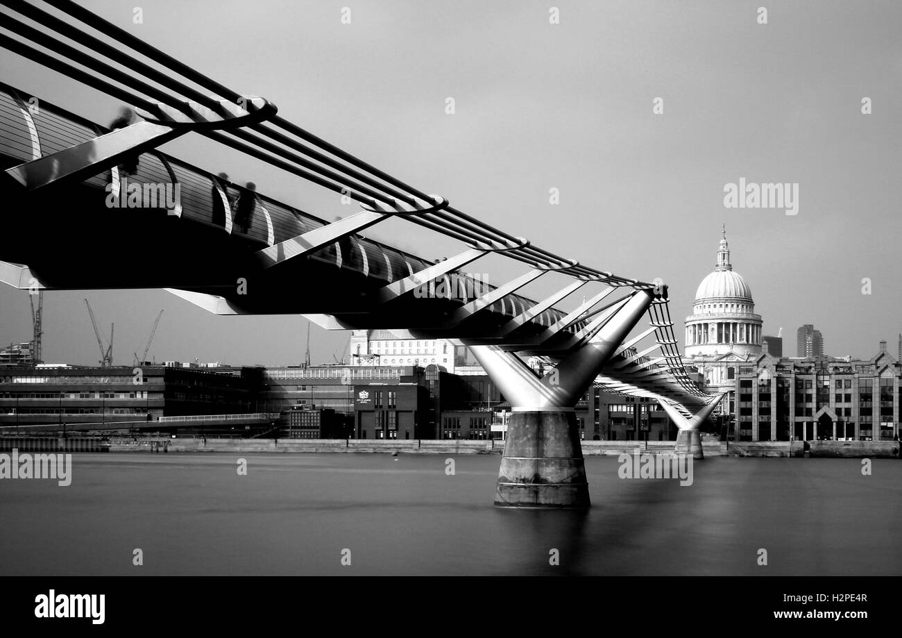 Black and White image of the Millennium Bridge over the River Thames in London. - Stock Image