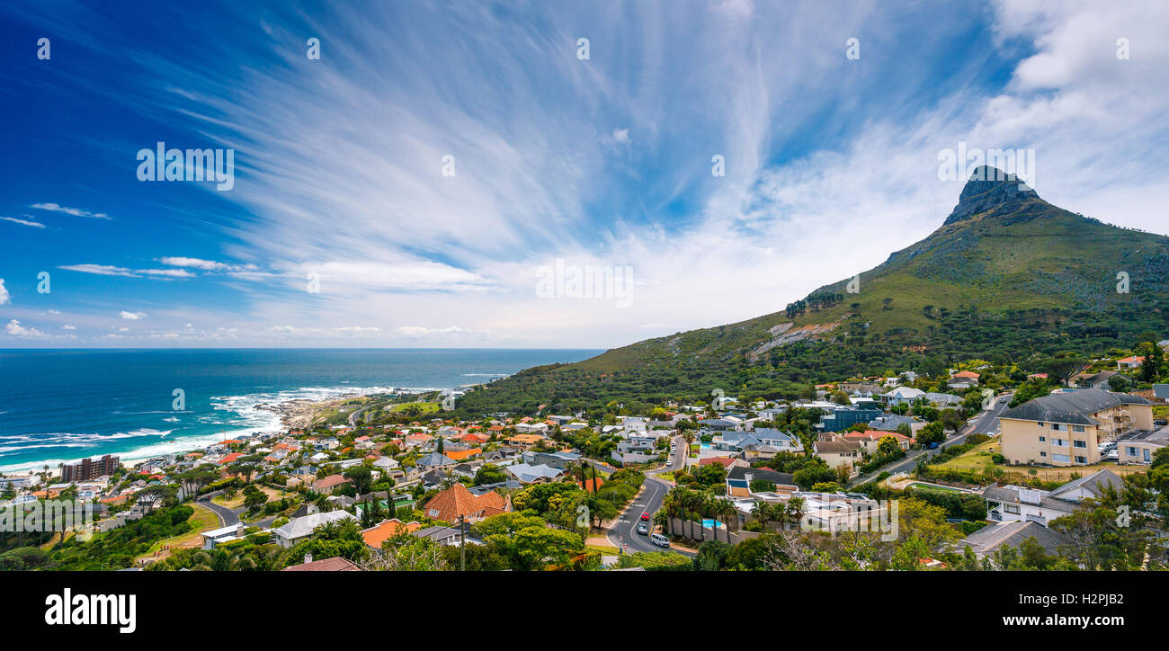 Camps Bay and Lion's Head mountain, amazing panoramic landscape of a coastal city, part of a Table Mountain - Stock Image