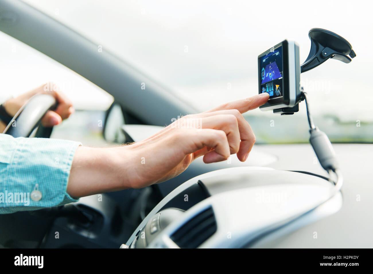close up of man with gps navigator driving car - Stock Image