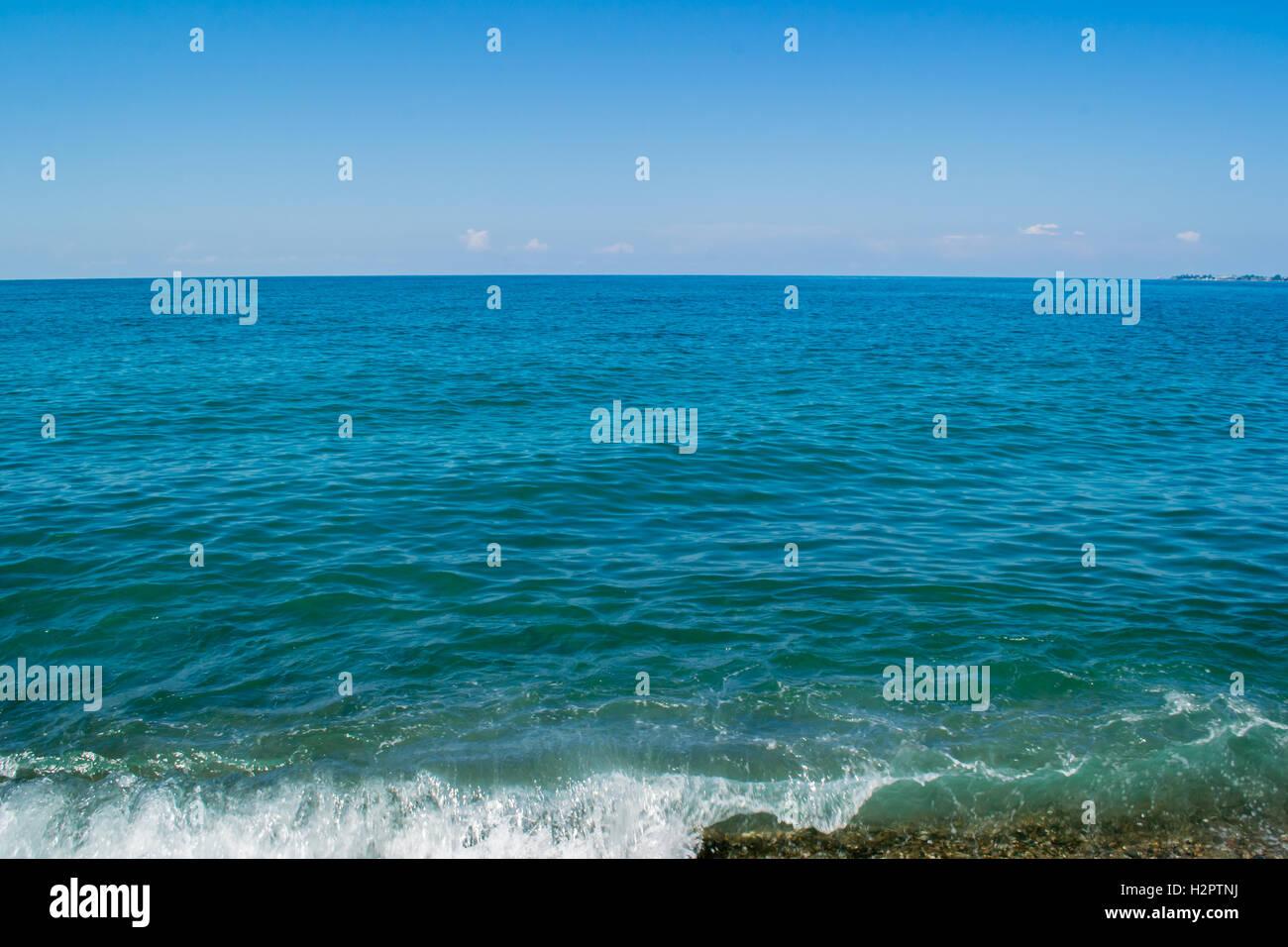sea waves beach sun summer bright colors - Stock Image