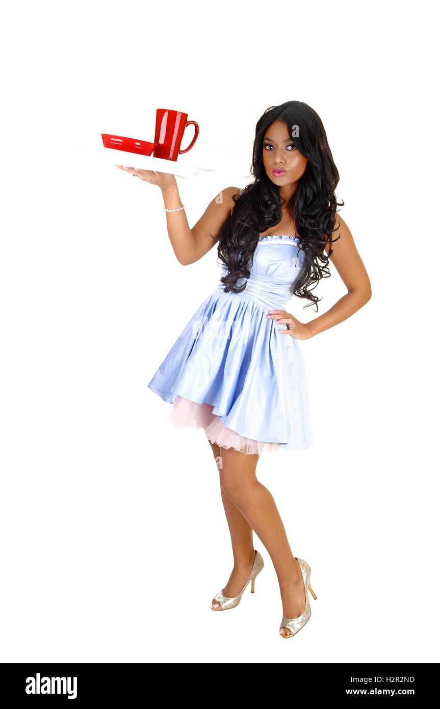 97b523a4fd A lovely young Asian woman in a light blue dress and long black hair  holding up a tray with a red cup for white background.