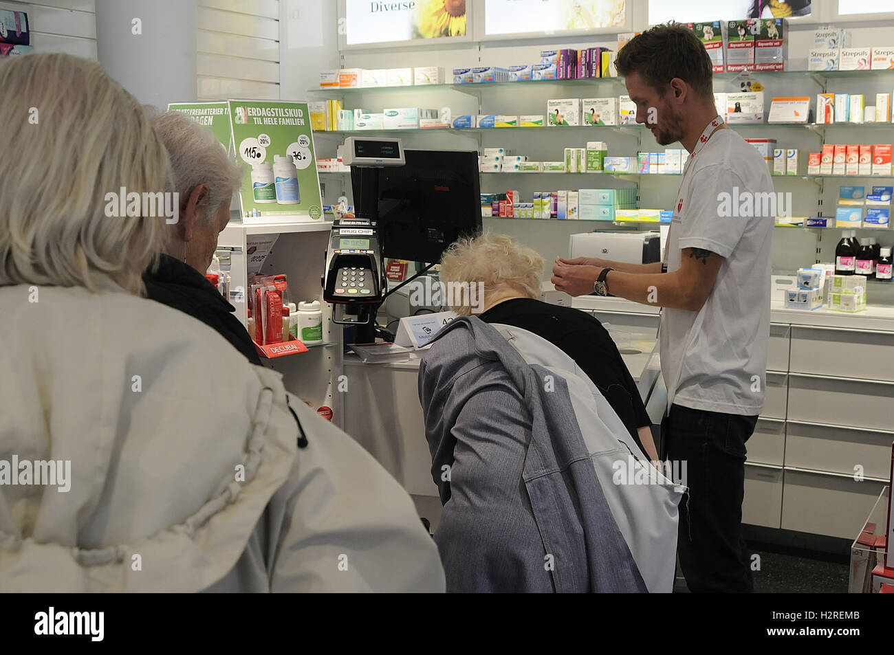 01 October 2016- Danish senior get injection for flue at Kastrup pharmacy, it is free for danish national and those Stock Photo