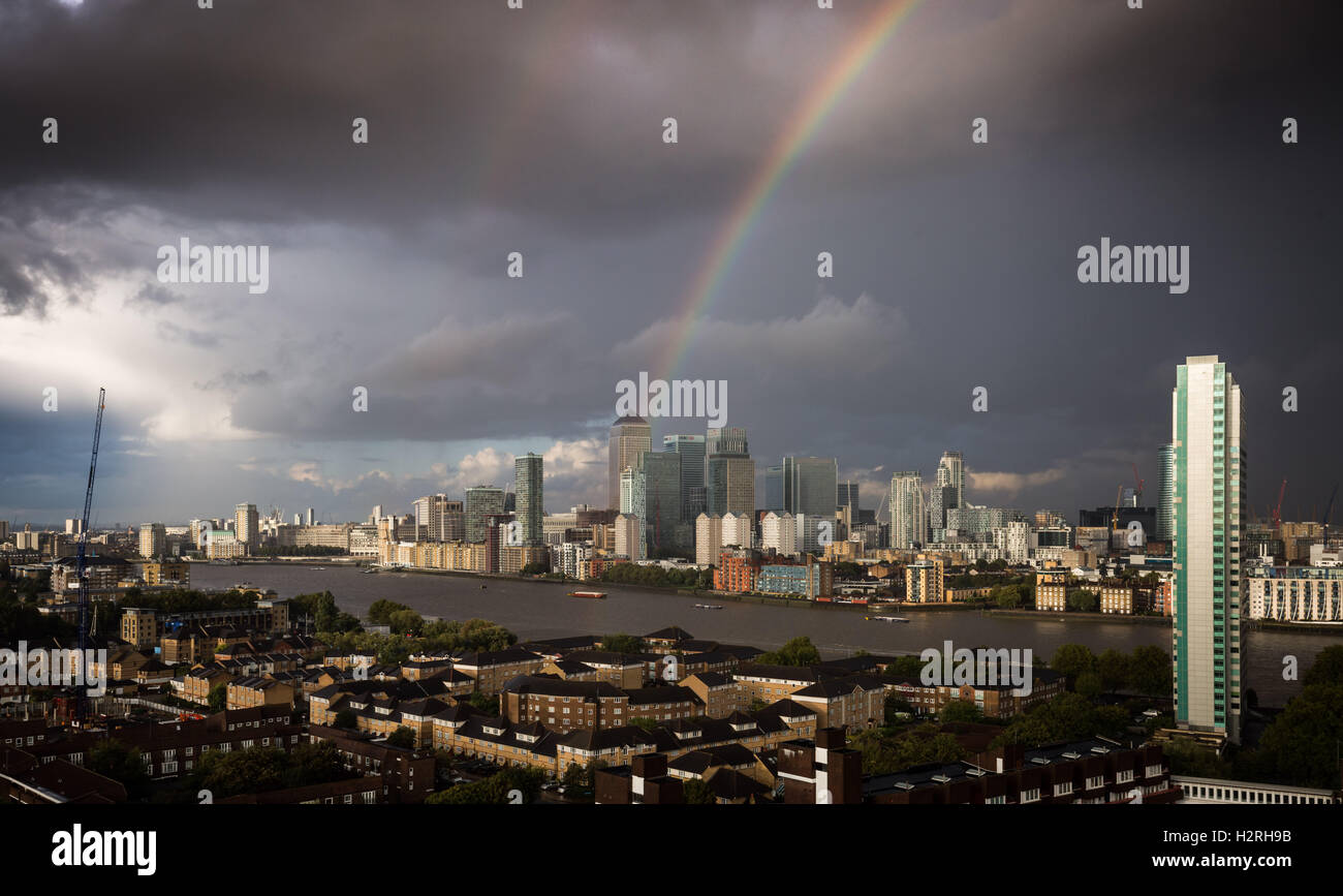 London, UK. 1st October, 2016. UK Weather: Colourful rainbow breaks after a brief afternoon rainstorm over south Stock Photo