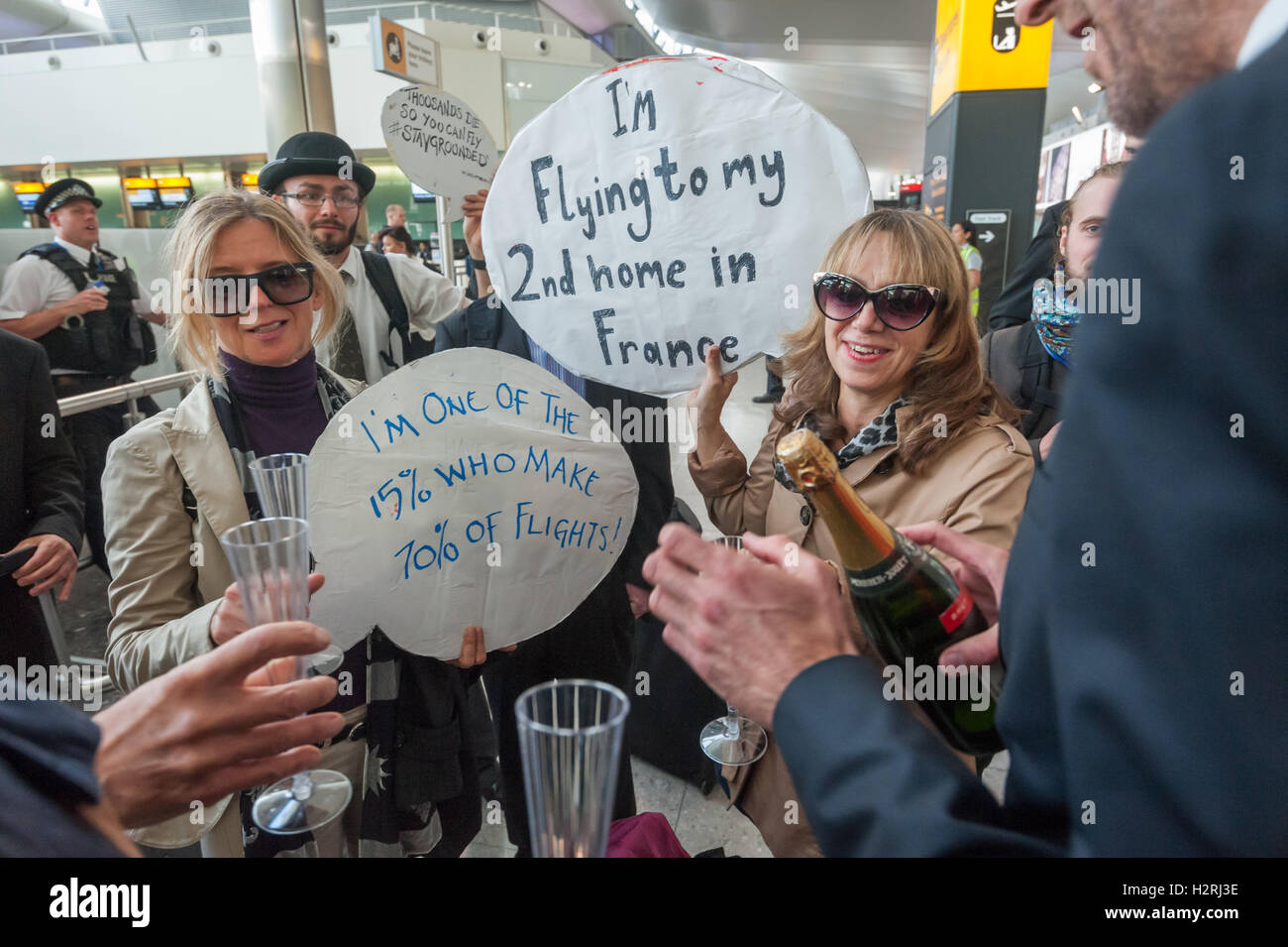 Heathrow, London, UK. 1st October 2016. . Protesters dressed as high polluting 'frequent flyers',  who have - Stock Image