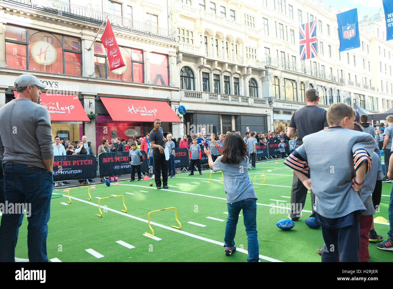 London, UK. 1st October 2016. Regents Street is pedestrianized for its 4th year NFL fan festival, more than 60,000 - Stock Image