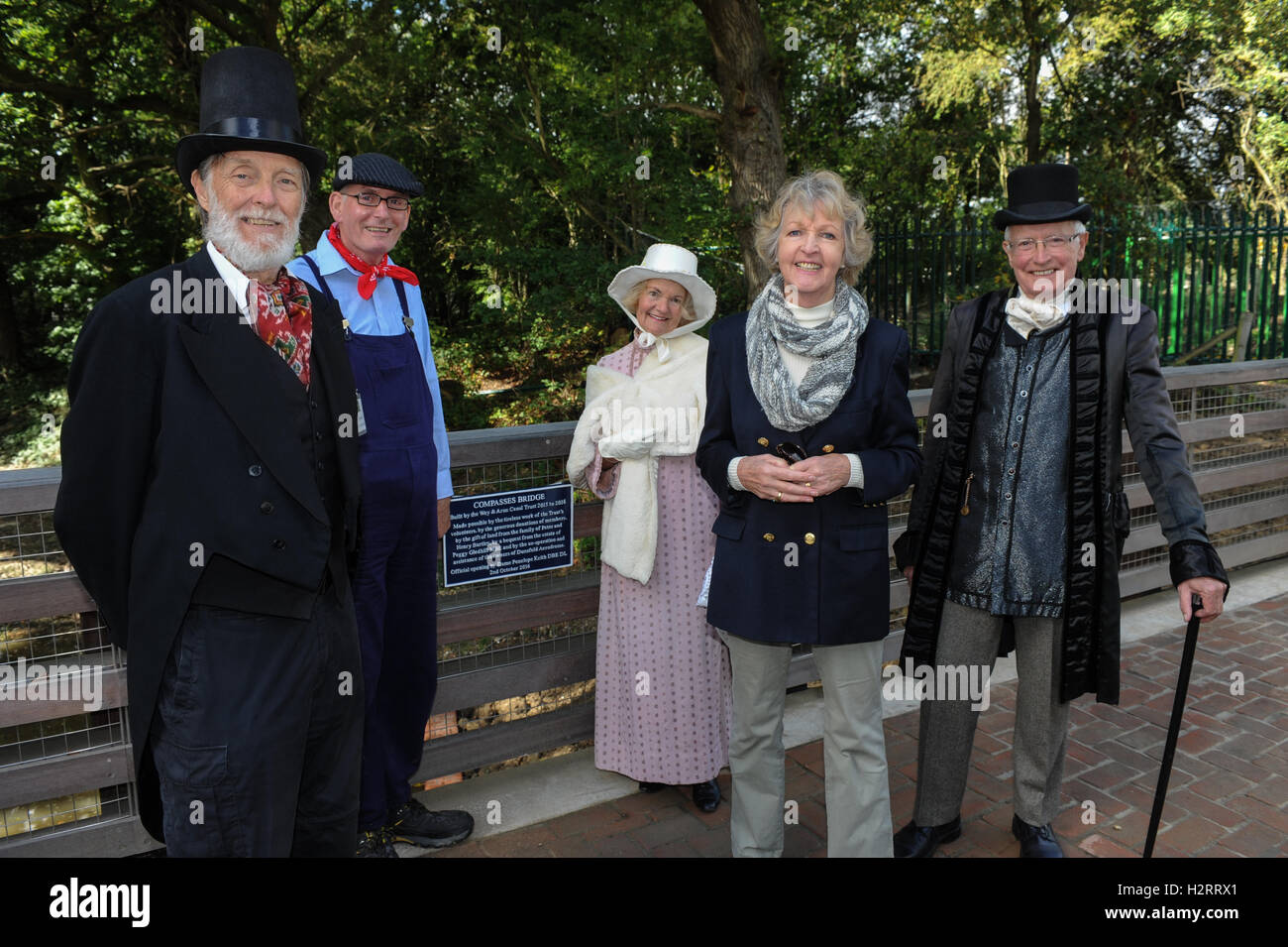 Actor Dame Penelope Keith stands with Wey & Arun Canal Trust volunteers on Compasses Bridge after the official - Stock Image