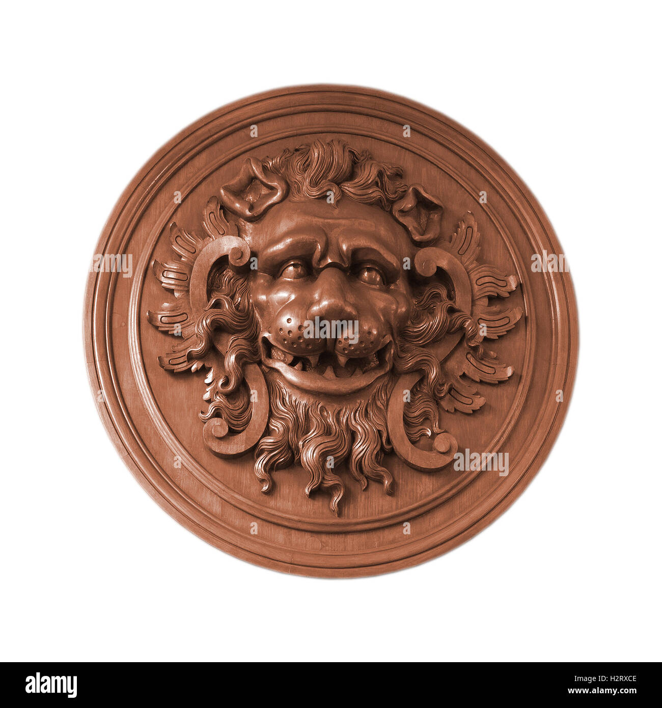 An object isolated on white: decorative old aged wooden bas-relief with lion head. - Stock Image