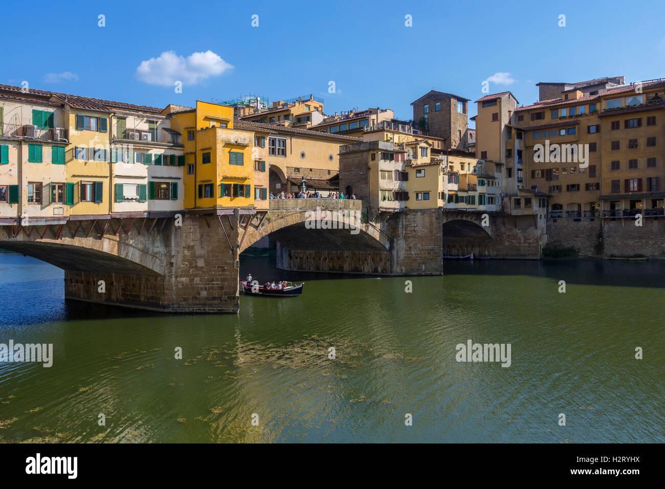 Florence, Italy - The Ponte Vecchio (Old Bridge] - a Medieval stone bridge over the Arno River. - Stock Image