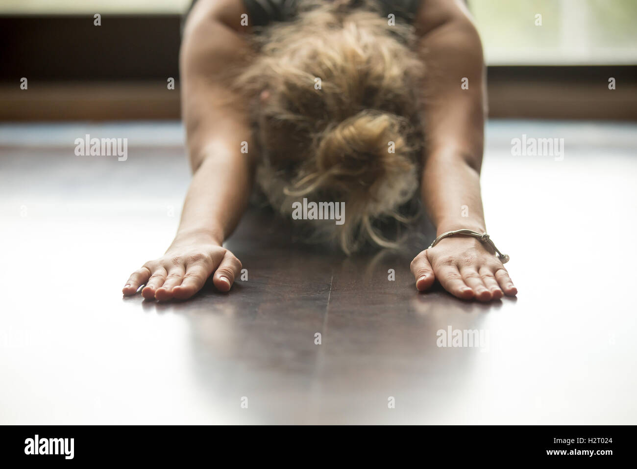 Yoga at home: Child Pose - Stock Image