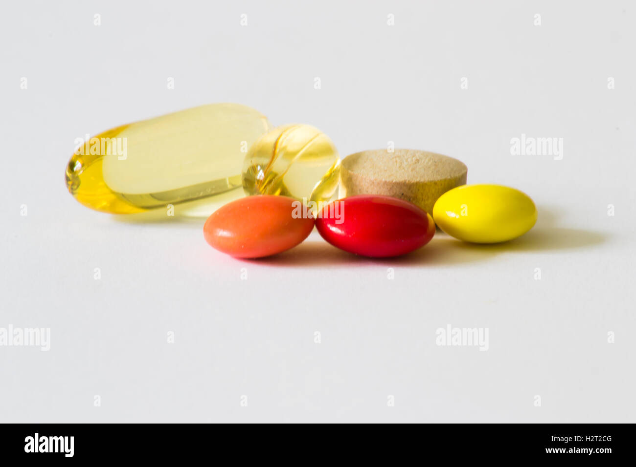 Pills on white background. Tablets. Supplements, vitamins, macro. - Stock Image