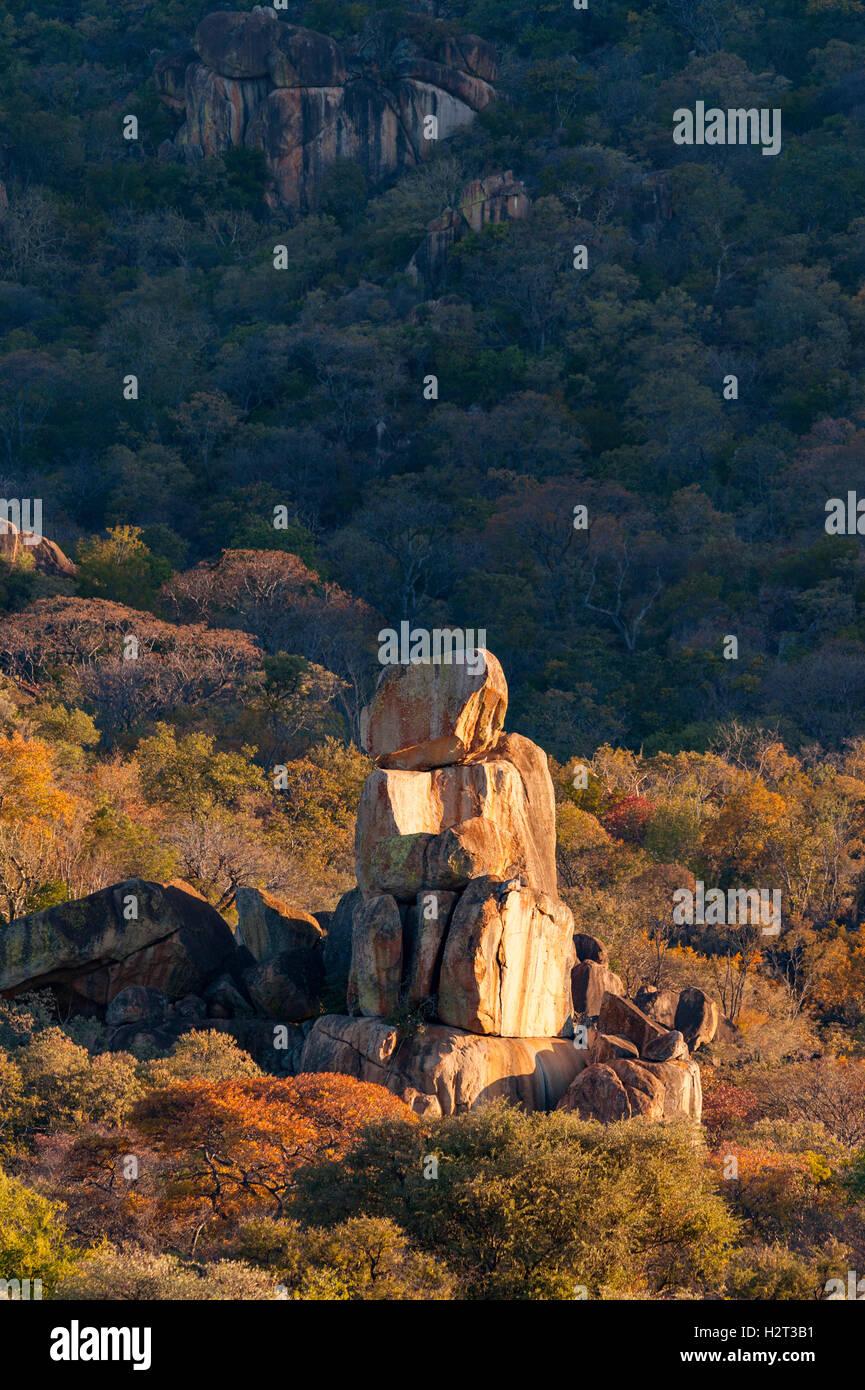 balancing rocks balance geology weathering granite shapes tumble down sunrise yellow golden light contrast contrasty - Stock Image