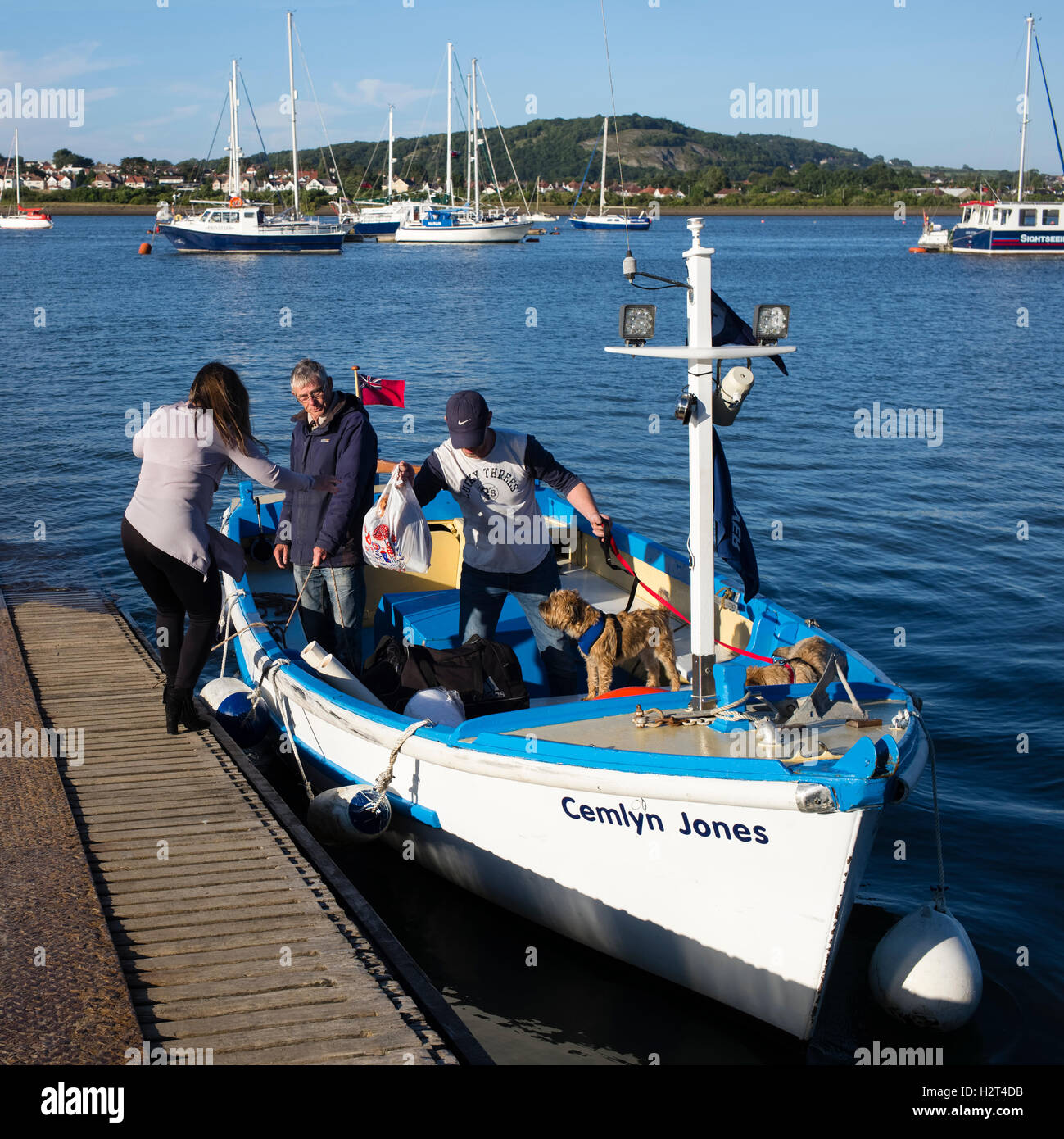 The Conwy water taxi taking-on passengers at the quayside, Conwy, Wales, UK - Stock Image