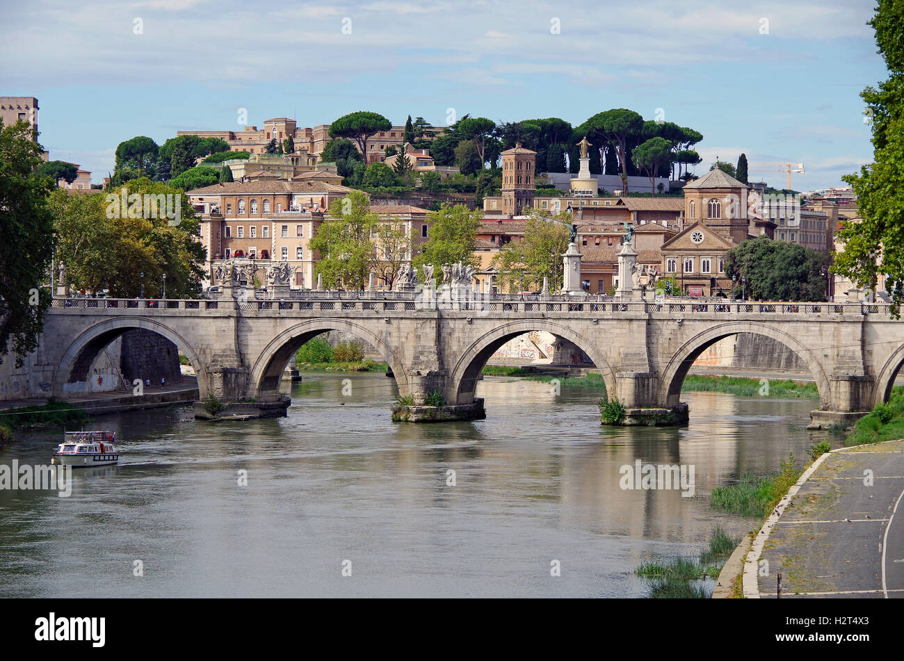 View from the Ponte S Angelo, westwards to the Vittorio Emanuele bridge and the Janiculum hill Stock Photo