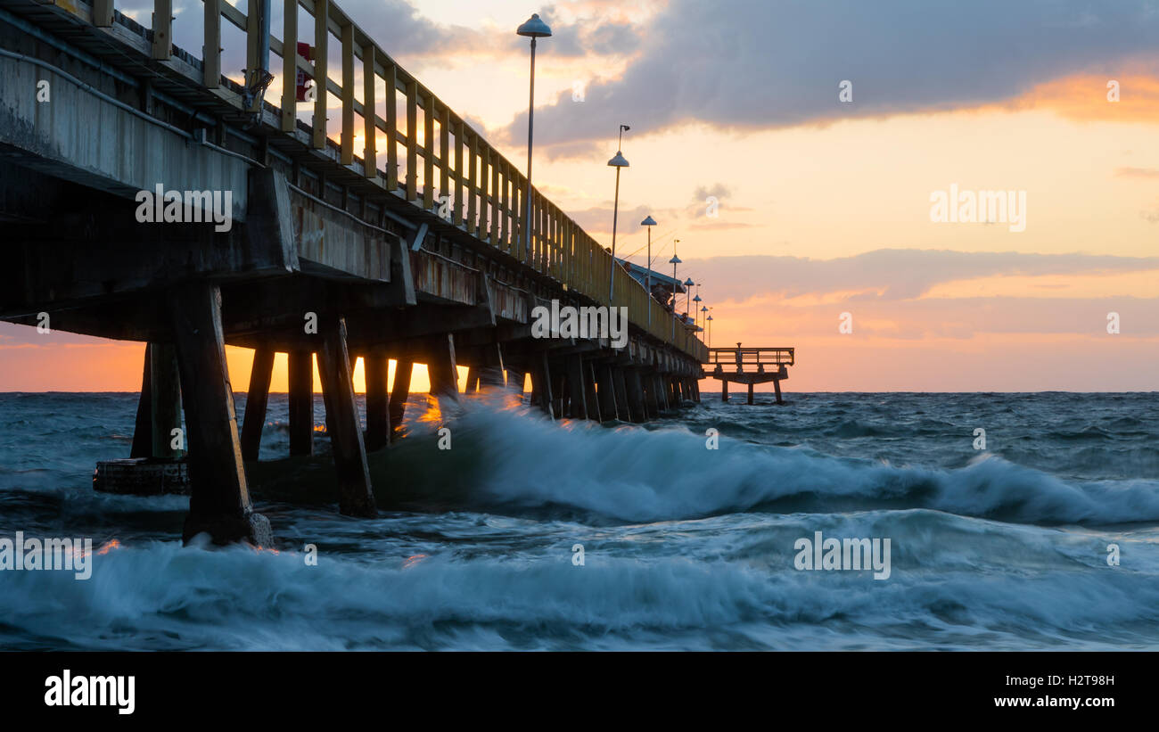 Pompano Beach Pier Broward County Florida at the Beach by sunrise. - Stock Image