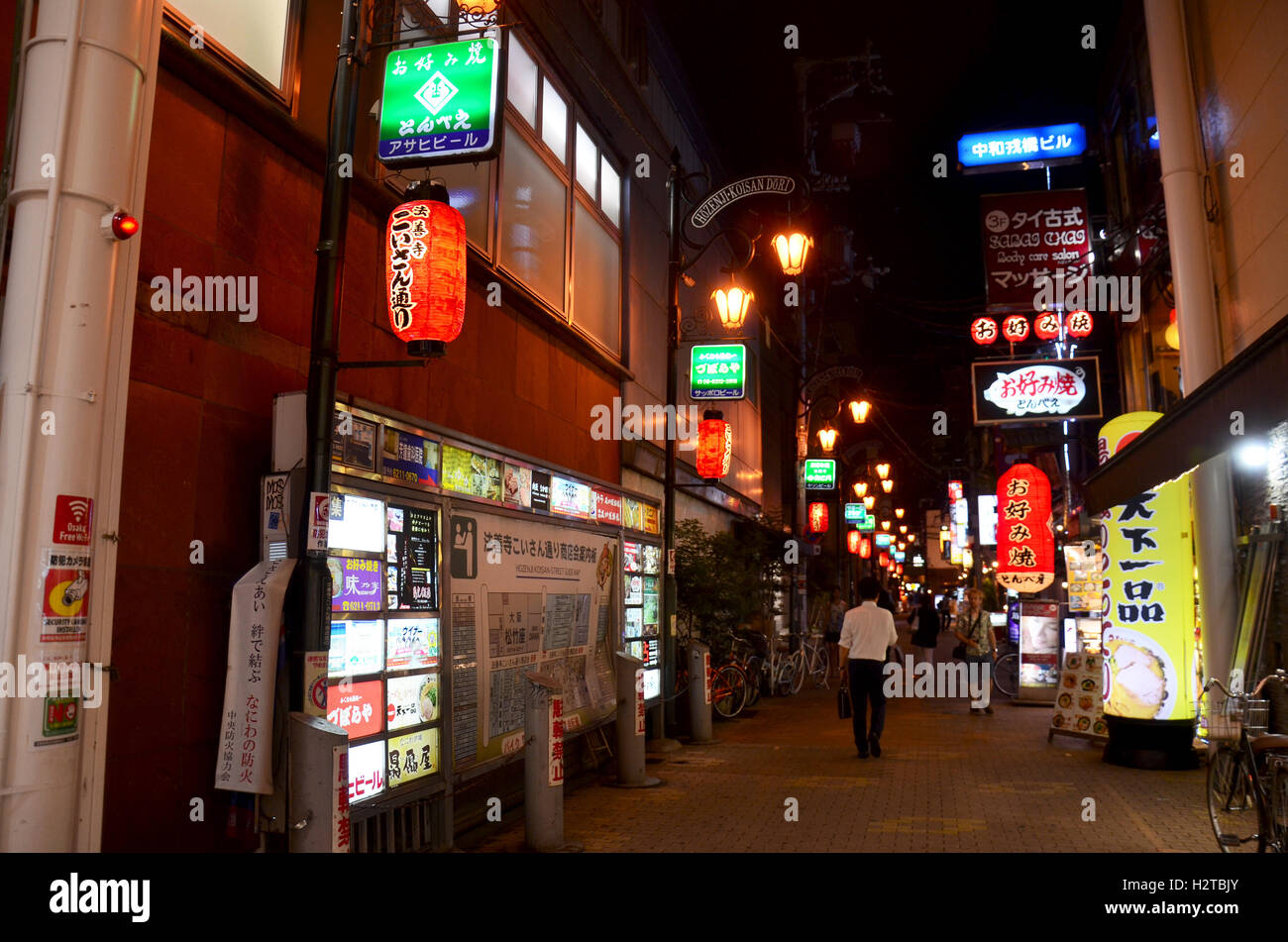 Japanese people and traveler foreigner walking in small alley in Dotonbori area for travel visit and shopping at - Stock Image