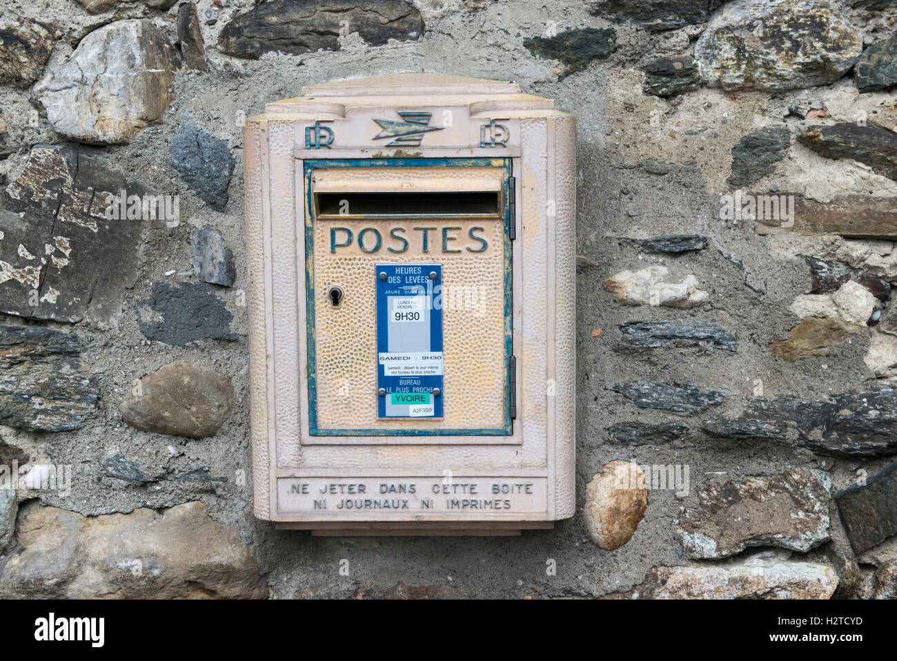 French letter box on a rock wall, medieval historic village of Yvoire, Haute-Savoie, France - Stock Image