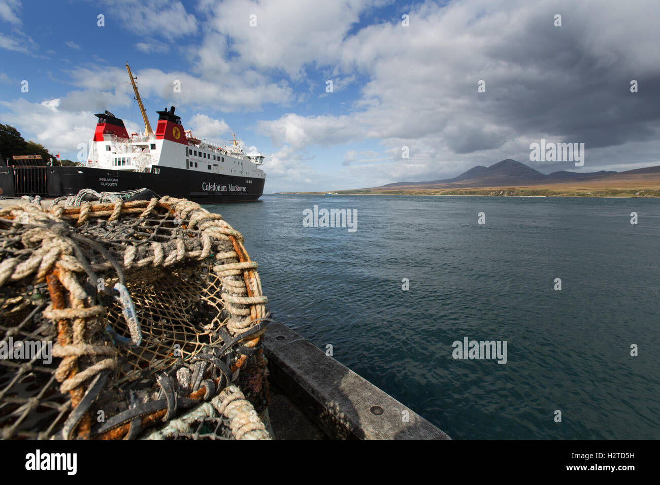 Isle of Islay, Scotland. Picturesque view of the CalMac ferry, MV Finlaggan, docked at Islay's Port Askaig. Stock Photo