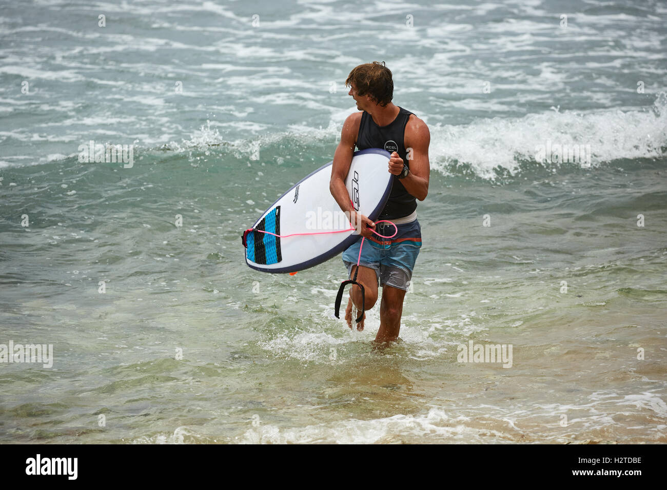 Barbados atlantic coast Bathsheba rocks   pretty Young male boy man surfing surfers copyspace surfboards waiting - Stock Image