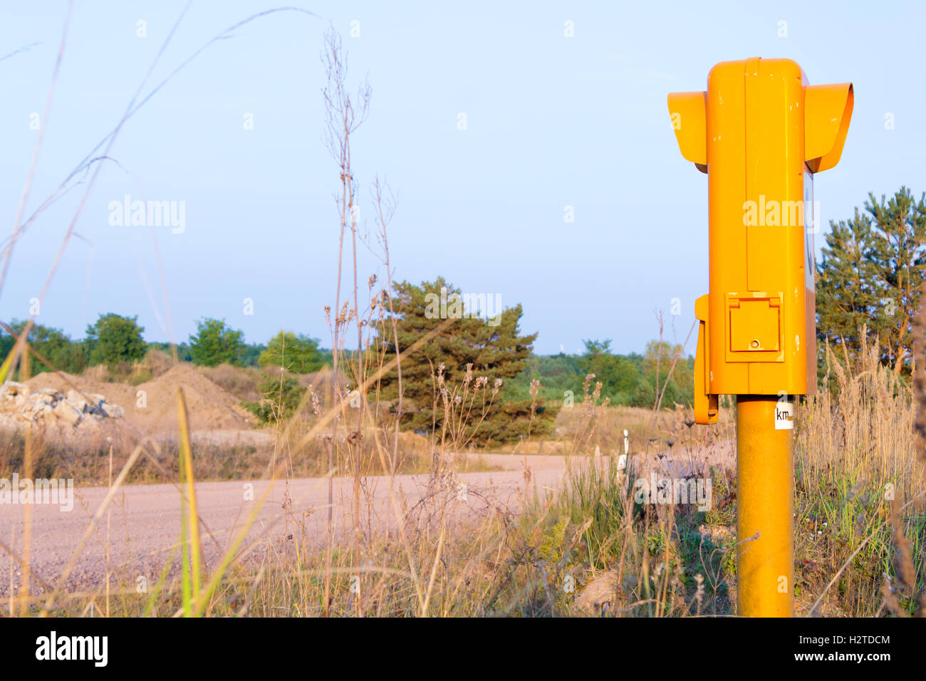 german sos call box on an empty road - Stock Image