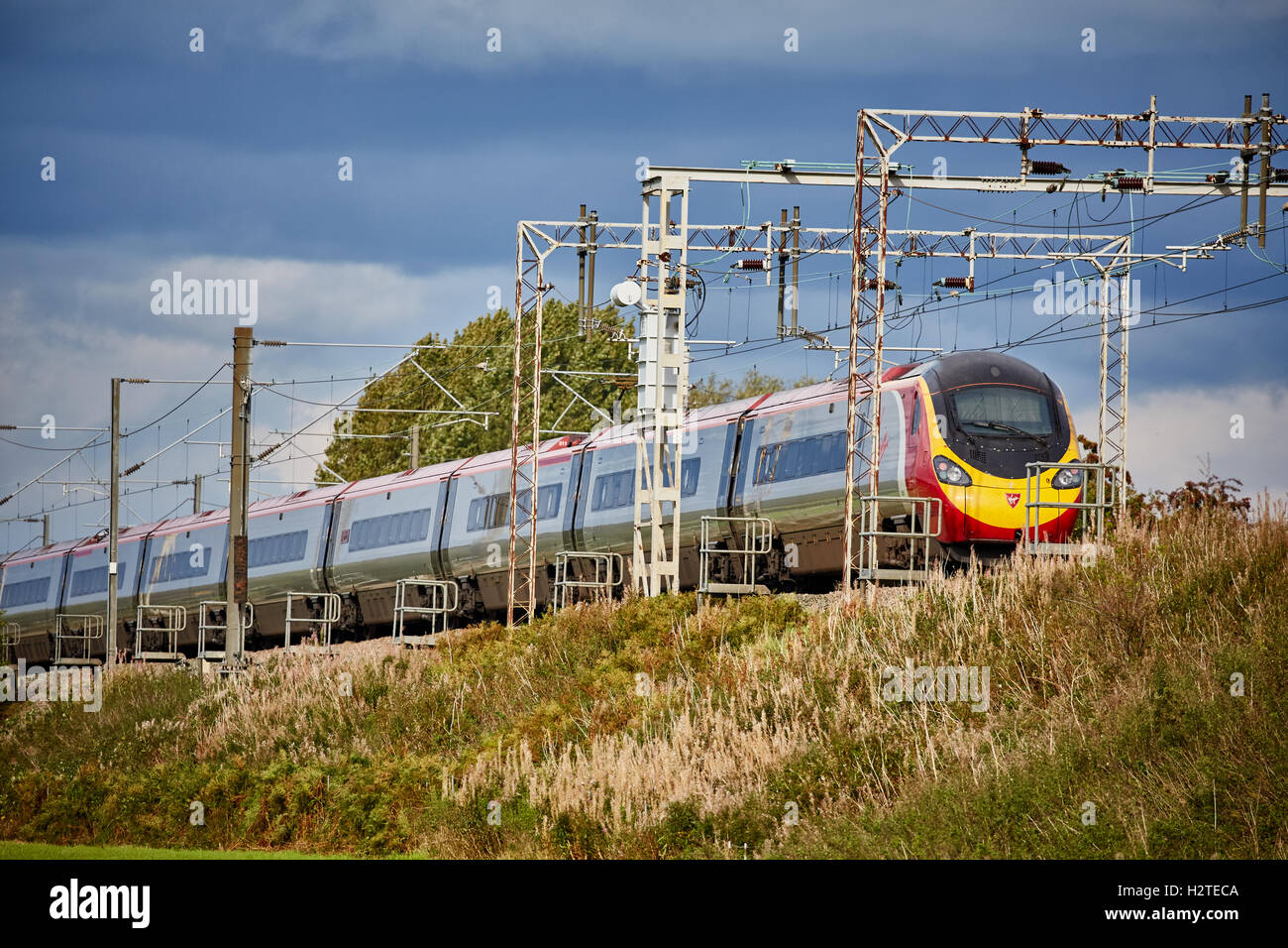 Railway Alstom Class 390 Pendolino  Adlington Manchester to Macclesfield line Transport transporter transportation Stock Photo