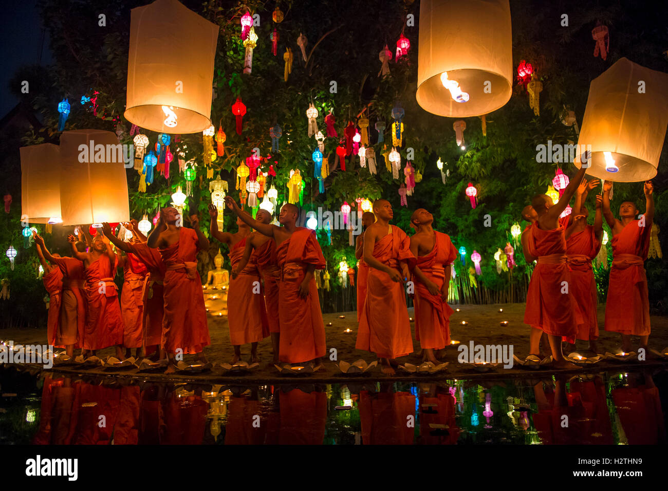 CHIANG MAI, THAILAND - NOVEMBER 07, 2014: Groups of young Buddhist monks launch sky lanterns at the Yee Peng festival Stock Photo